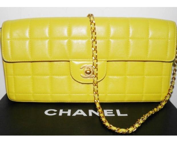 Bolso de mano amarillo. De las marcas más exclusivas