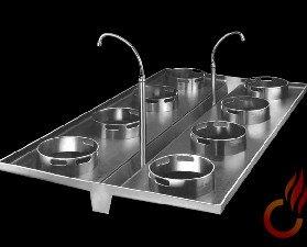 Cocina serie A. Canalón de evacuación y grifos de toma de agua en el centro.