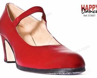 Zapato profesional. Zapato de flamenco profesional con goma forrada de piel, suela de cuero pegada y cosida con tapas en punta y tacón con clavos pulidos y filis...