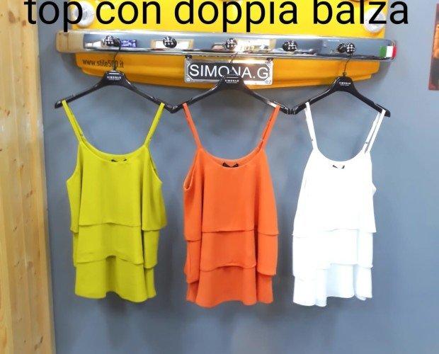 Blusas para chicas. Blanco, amarillo y naranja