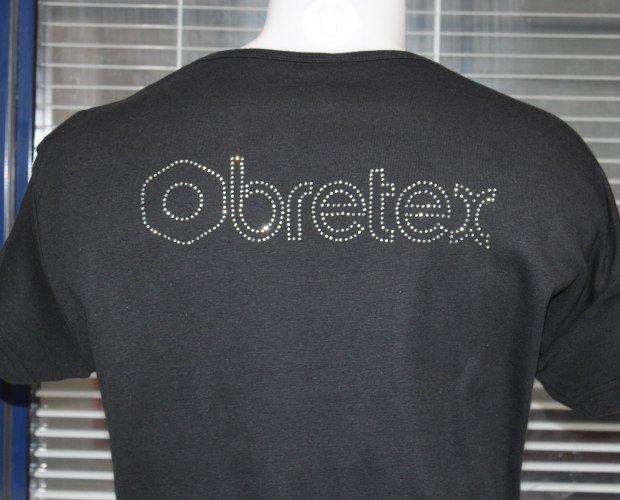 841. logo echo con pedreria textil. en los talleres de obretex