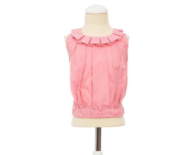 Camisa para Niña. Confeccionada en plumetti rosa con detalle en el cuello.
