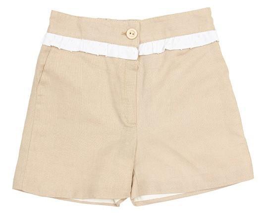 Pantalón corto para Niña. Pantalón niña dulce confeccionado en lino color piedra con pequeñovolante en la cintura en plumetti bicolor a juego con la...