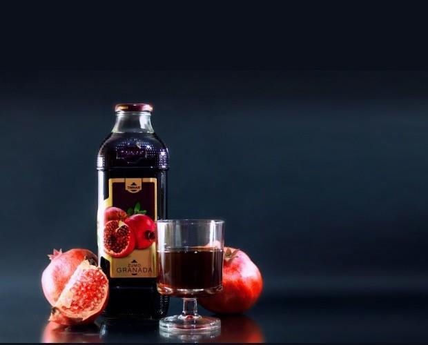 Zumos Concentrados.Zumo 100% Granada Premium, botella cristal 1 lt